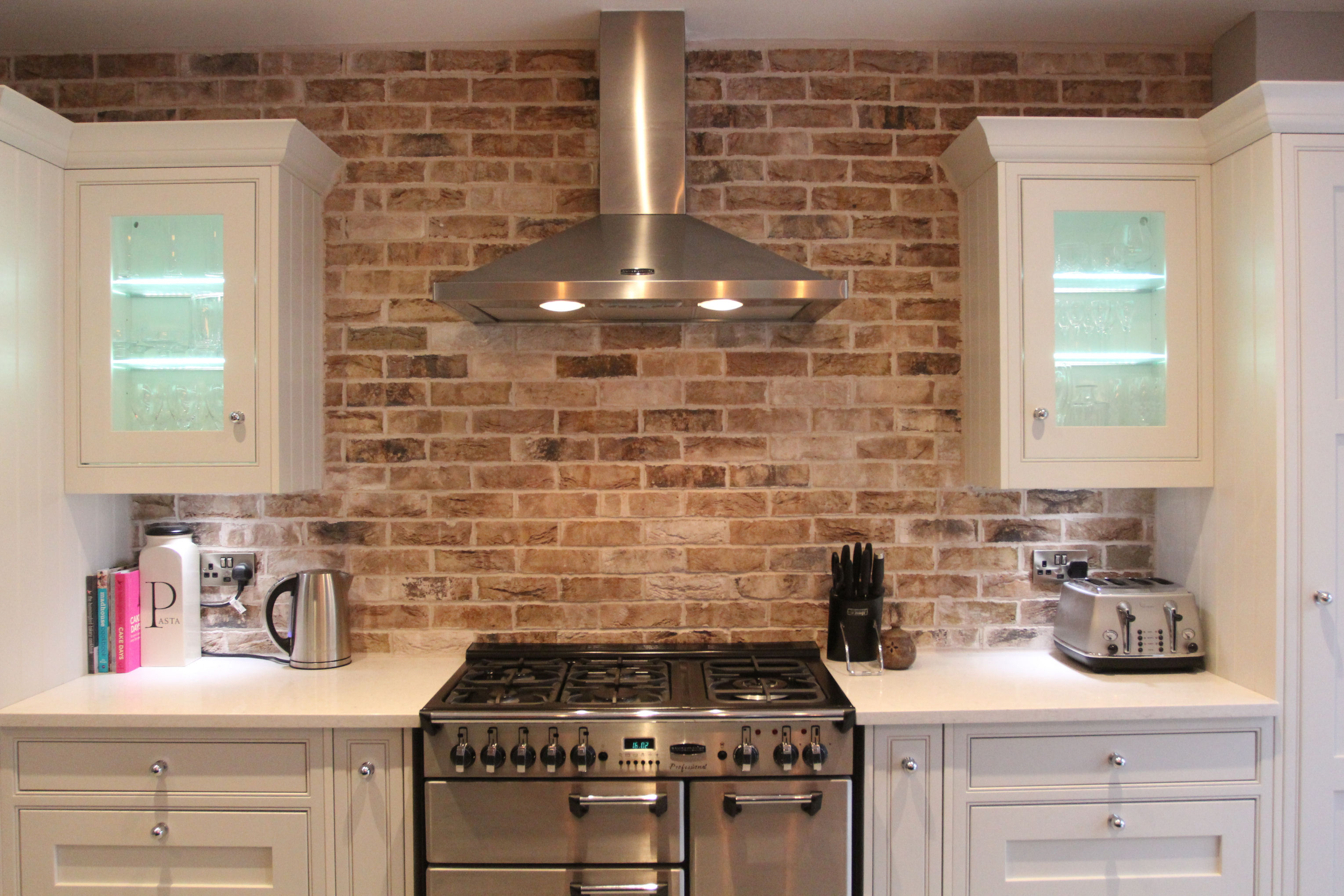 White Cabinets Black Countertops Brick Backsplash